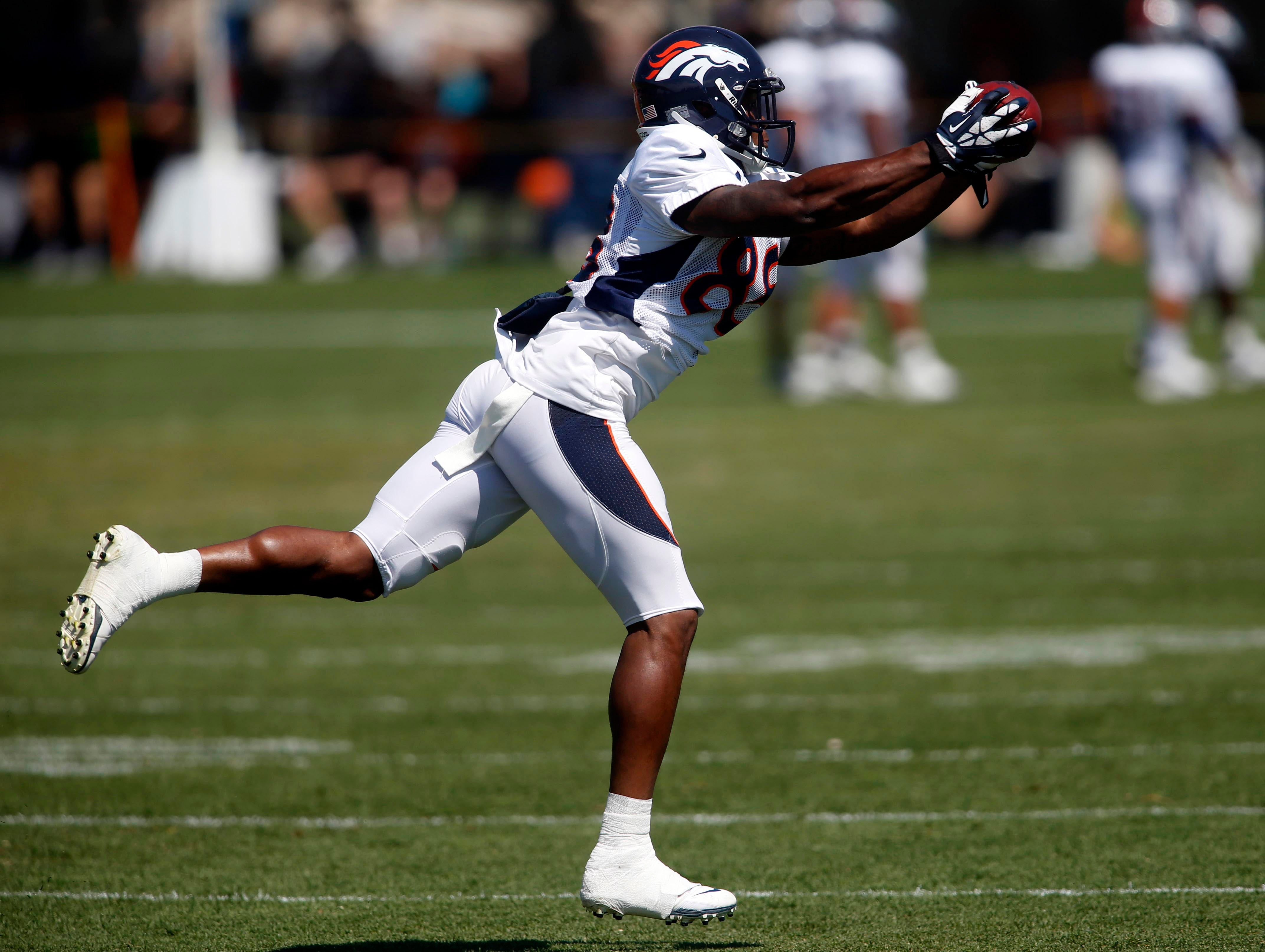 Denver Broncos wide receiver Demaryius Thomas catches a pass during training camp at the Broncos training facility on Aug. 12.