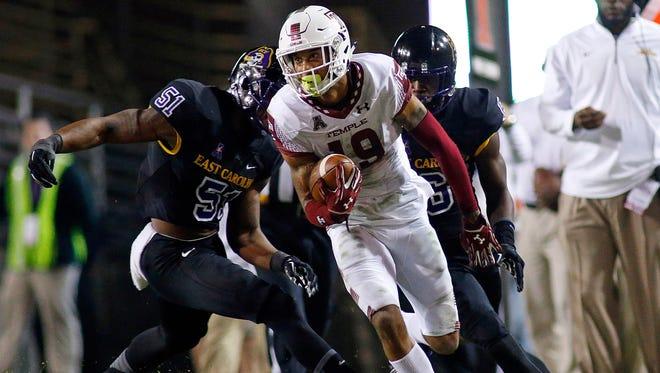 Temple's Robby Anderson (19) breaks away from East Carolina's Montese Overton (51) and DaShawn Benton (6) during the second half of an NCAA college football game in Greenville, N.C., Thursday, Oct. 22, 2015. (AP Photo/Karl B DeBlaker)