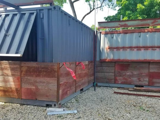 Shipping containers make up the structures in the baaree