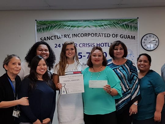 Emmy Sheedy from Guam High School, Shieh athletic scholarship recipient donates her $1000 Scholarship to Sanctuary Incorporated of Guam to benefit the youth and families Sanctuary serves. Sheedy is a regular volunteer of Sanctuary and holds the title of Miss Guam Earth 2017.  Sanctuary thanks Emma and wishes her the very best as she prepares to leave for college. Pictured from left: Nona Bautista, Sanctuary; Lakretia Castro-Santos, Sanctuary; Lani Giltinag (back); Emma Sheedy; Theresa Arriola executive director Sanctuary; Kathy Dominguez, Sanctuary, Sarita Ilesugam, Sanctuary, Gene Anderson, Sanctuary.