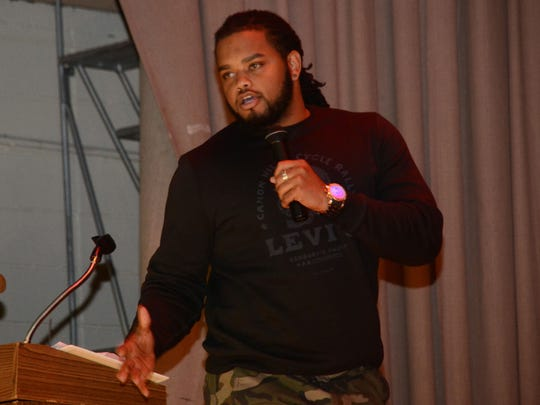 Joshua Edwards, a Louisiana College football player and a member of Christian Worship Center, speaks about how bad life decisions led him to be a bully at an anti-bullying rally at Alexandria Middle Magnet School on Thursday.