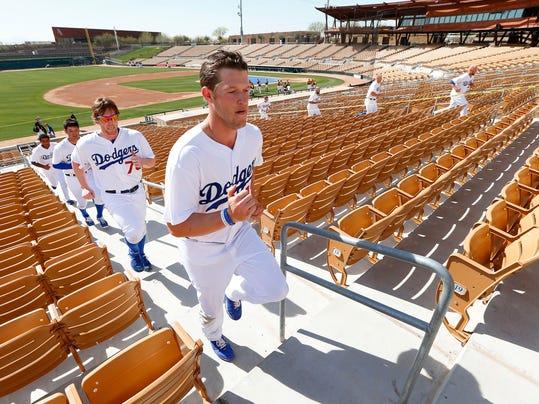 Los Angeles Dodgers pitcher Clayton Kershaw leads teammates running stairs during spring training baseball practice in Glendale, Ariz., Friday, Feb. 14, 2014. (AP Photo/Paul Sancya)