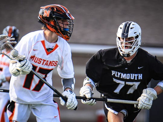 Although Jack Harris (17) has the ball for Northville,