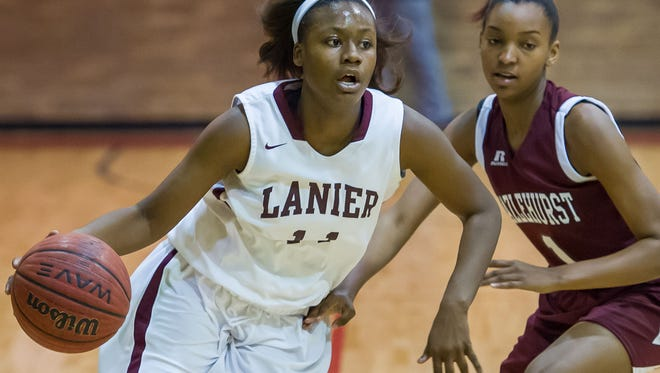 Lanier's Brittany Rose (11) drives against Hazlehurst's Jamiah McKenzie (1) during JPS Tournament play at Provine Monday December 28, 2015.