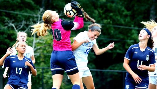 Goalkeeper Arianna Jobst of MKA making a save against Montclair.