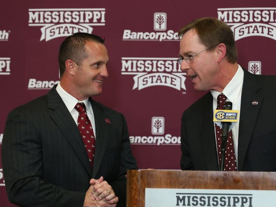 Mississippi State athletic director John Cohen (right) introduces the program's new baseball coach Andy Cannizaro on Monday.