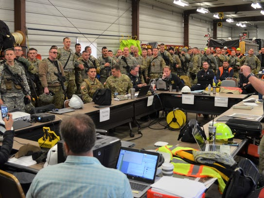 Members of Wisconsin National Guard are briefed before GridEx IV, a disaster scenario event held last year at Alliant Energy's Columbia Energy Center generating station near Portage. Alliant Energy will also participate in the upcoming Dark Sky exercise and will host the National Guard and other partners for three days beginning Tuesday.