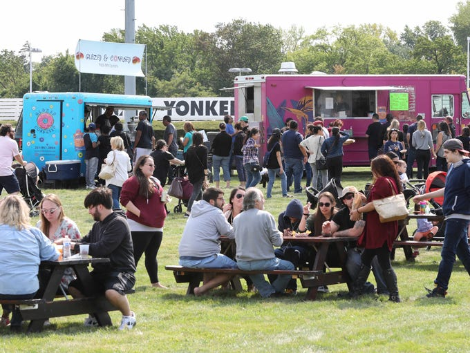 People line up for food at the various food trucks