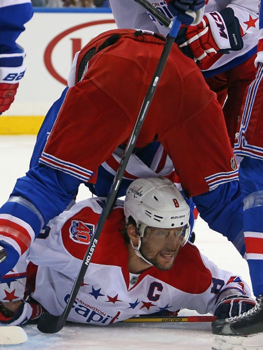 staal-on-top-of-ovechkin.jpg