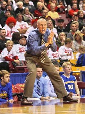 Cathedral head coach Matt Meyer, shown here during a Classs 2A state tournament game last March, said the number of boys out for Cathedral basketball in grades 7-12 is 85, the most he's seen in his tenure there.