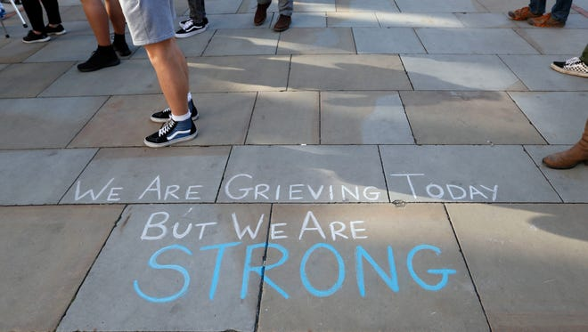A message is written on the pavement in Manchester, England, on May 23, 2017.