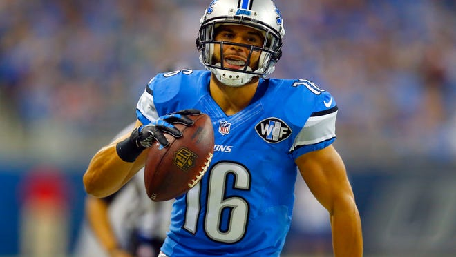 Detroit Lions wide receiver Lance Moore runs with the ball after a catch against the Detroit Lions during an NFL football game, Thursday, Nov. 26, 2015, in Detroit.