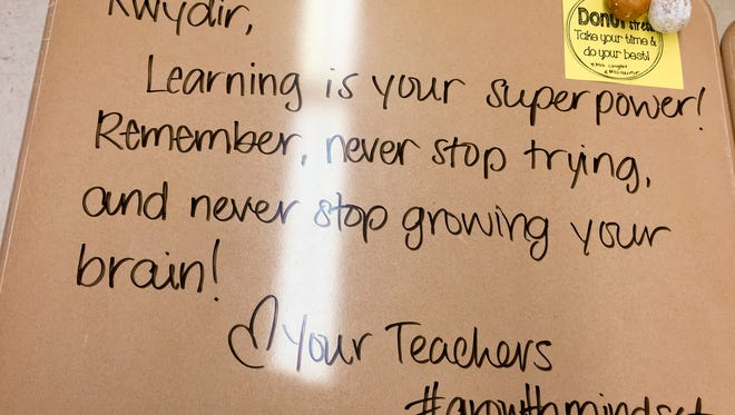 An inspirational message is written on a student's desk in Chandni Langford's fifth-grade classroom, in Woodbury.