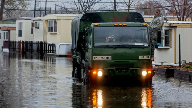 In this Oct. 30, 2012 file photo, a National Guard vehicle drives through the flooded Metropolitan Trailer Park in Moonachie. A proposal that would have addressed flooding from the Hackensack River was not among those selected for federal disaster money last month.