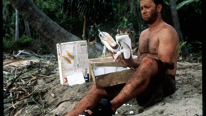 Tom Hanks survives four years on an isolated island using just his wits and the contents of several FedEx packages that washed ashore with him.