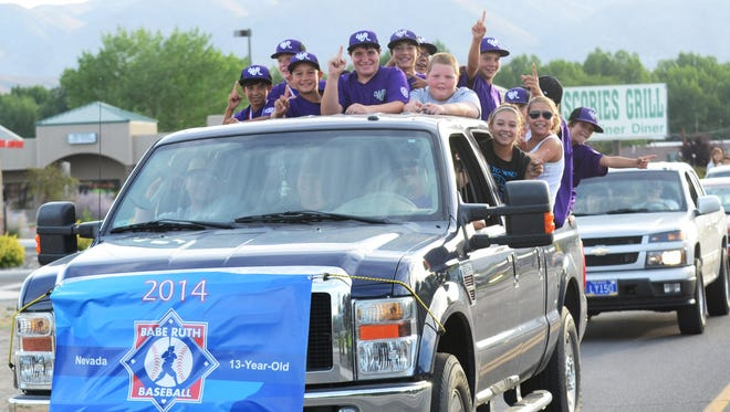 The state tournament-winning Walker River Babe Ruth 13 team parades through Yerington Sunday evening, with police cars, firefighting apparatus and other cars accompanying them down Bridge and Main streets.