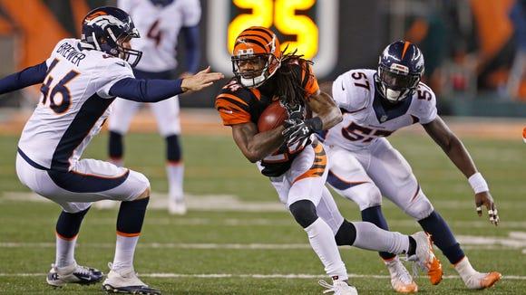 Bengals cornerback Adam Jones fights for yards during