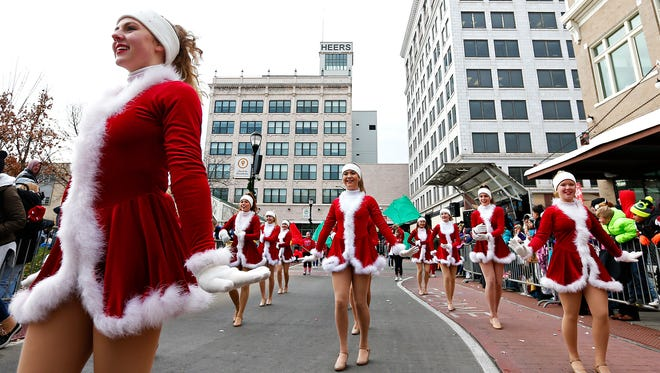 The Glendale High School Crimson Girls perform during the Christmas parade in downtown Springfield in 2016.