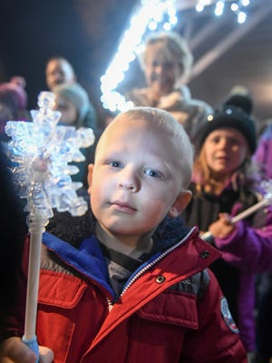 Henry Main, 4, poses for a photo on Sunday, Nov. 26, 2017, during Waukee's Annual WinterFest Celebration.