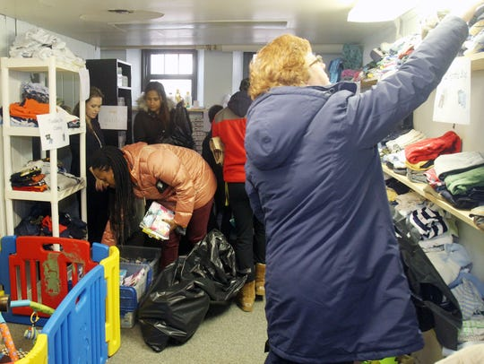 People look through the items at the United Way Children's
