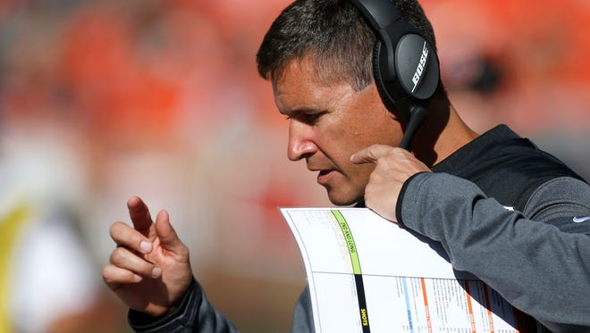 """Cincinnati Bengals offensive coordinate Bill Lazor sets up the next series in the fourth quarter of the NFL Week 4 game between the Cleveland Browns and the Cincinnati Bengals at FirstEnergy Stadium in downtown Cleveland on Sunday, Oct. 1, 2017. The Bengals tallied their first win of the season, 31-7, in the """"Battle for Ohio"""" game."""