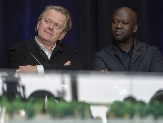 Michael Van Valkenburgh of Michael Van Valkenburgh Associates, left, and David Adjaye of Adjaye Associates, sit behind the winning design of the West Riverfront after the announcement on Tuesday, April 10, 2018, at the General Motors Renaissance Center in Detroit.