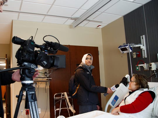 Tahera Rahman, 27, holds the microphone for Janice