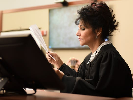 Circuit Judge Rosemarie Aquilina looks at a letter