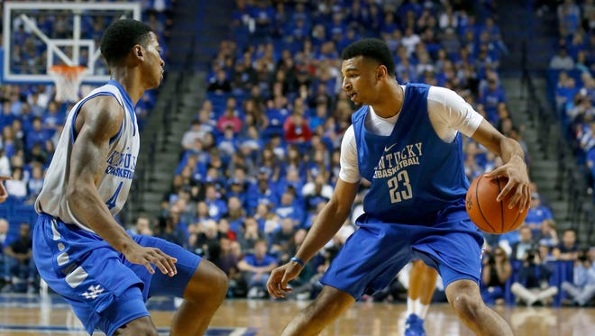 Oct 27, 2015; Lexington, Kentucky, USA; Kentucky Wildcats guard Isaiah Briscoe (13) dribbles the ball against guard Charles Matthews (4) in the first half of the Blue White scrimmage at Rupp Arena. Mandatory Credit: Mark Zerof-USA TODAY Sports