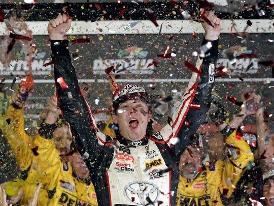 Erik Jones celebrates in Victory Lane after winning the NASCAR Cup Series auto race Saturday at Daytona International Speedway.