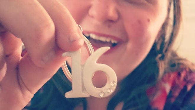 Simi Valley resident Aubree Rosenblum, who will turn 16 on Sept. 23, shows off one of the keychains that was sent to her after her mom began a social media campaign.