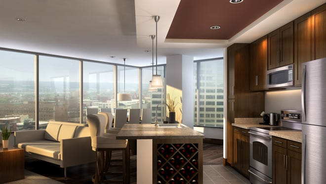 A rendering of the interior and view from an apartment in the AT580 building Downtown.
