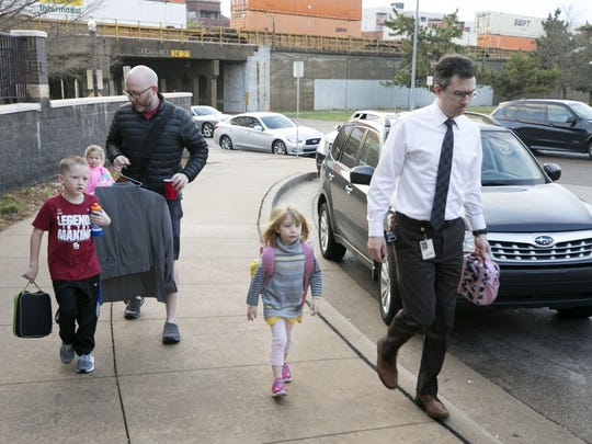Matthew Smith (left) of Oklahoma City, drops off his children, Gabe Smith, 7, and Maggie Smith, 4, as Kyle Wackenheim (right) of Oklahoma City, drops off his daughter, Harper Wackenheim, 5, at the Edward E. Gaylord Downtown YMCA in Oklahoma City, before they head to work on the second day of the Oklahoma teachers walkout, on Tuesday, April 3, 2018. The YMCA extended their before- and after-school program hours to help working parents because of the teacher walkout.