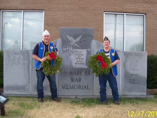 Volunteers placing wreaths at the Stewart County War