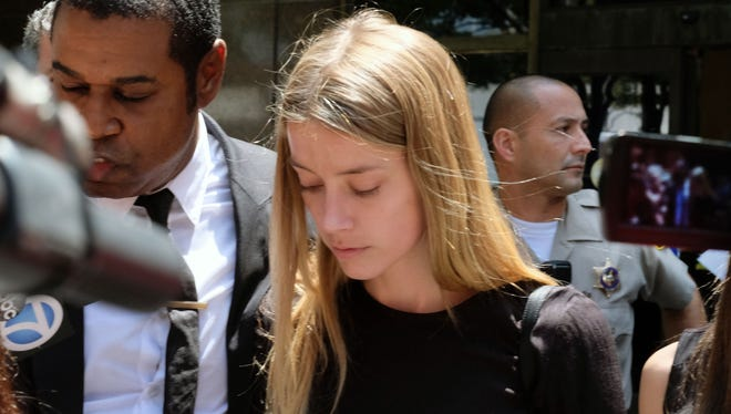 Amber Heard submitted sworn declaration at Los Angles Superior Court on May 27, claiming husband Johnny Depp threw her cellphone at her during a fight Saturday, striking her cheek and eye. The judge issued a restraining order telling Depp to stay away from his estranged wife.