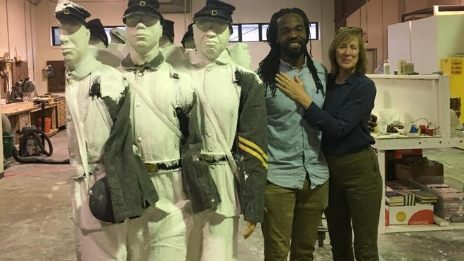 Artist Stephen Hayes (left) and Cameron Art Museum executive director Anne Brennan with casts of his U.S. Colored Troops sculpture, which will be installed at the museum in 2021.
