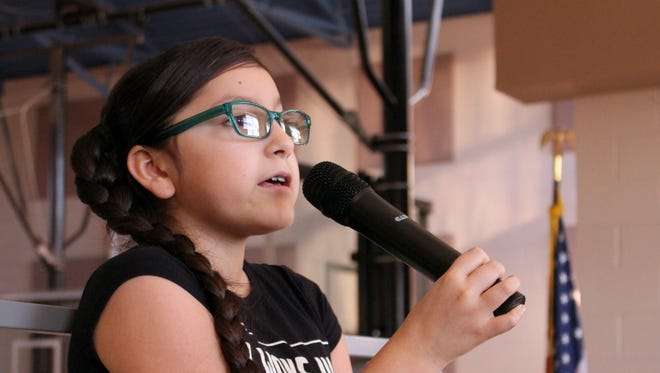 Micah Martinez practices her vocal warms ups for her performance Thursday at the New Mexico Legislature where she will be singing the National Anthem to open op the day. Martinez, a fifth grader at Ruben S. Torres Elementary School, will be accompanied by her music teacher Brandon Perrault and her family.