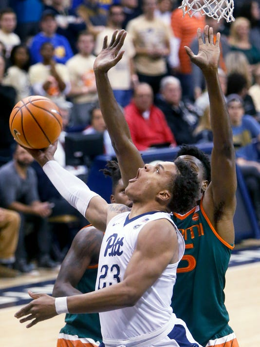 Pittsburgh's Shamiel Stevenson (23) shoots in front of Miami's Ebuka Izundu (15) during the first half of an NCAA college basketball game, Saturday, Dec. 30, 2017, in Pittsburgh. (AP Photo/Keith Srakocic)
