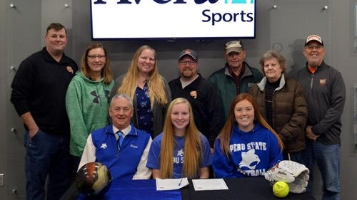 Kassidy Haberman (center front) became Peru State's first-ever bowling signee! With Haberman on front row (l to r): Peru State associate athletic director/sports information director Ted L. Harshbarger and Whitley Albury, Bobcat assistant softball coach. In the back row (l to r): Kevin Haberman,  Mary Haberman, Hope Showalter, Derek Schumacher (bowling coach),  grandparents Vernon and Sharon Haberman, and Greg Wylie
