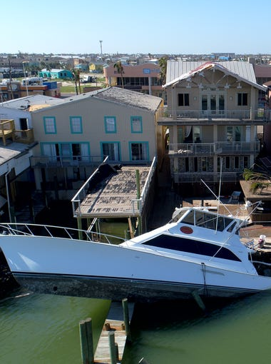 The bow of this partially submerged yacht was left dangling over a pier in Port Aransas after Harvey passed through.
