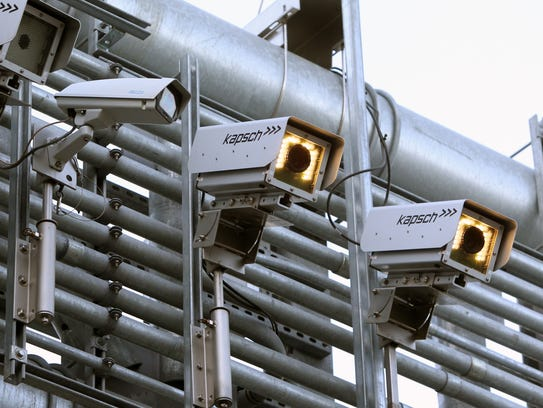 Cameras mounted on the electronic toll gantry for the