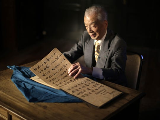 In this April 29, 2015 photo, Yoshiomi Yanai, a survived kamikaze pilot, shows his last will and testament which he made as a kamikaze pilot in 1945 during an exclusive interview with the Associated Press at Tsukuba Naval Air Group Base in Kasama, Ibaraki Prefecture, north of Tokyo.