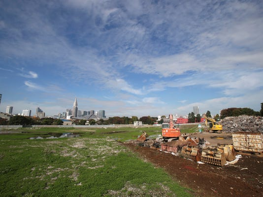 """FILE - In this Nov. 16, 2015, file photo, parts of demolition equipments and the rubble of Japan's National Stadium demolished for the renovation for the 2020 Olympic games are collected at one corner of the vacant site shown to the media for the first time after the completion of the demolition work in Tokyo.  The price tag of the 2020 Tokyo Olympics could exceed 3 trillion yen ($30 billion) unless drastic cost-cutting measures are taken and several key venues are relocated, an expert panel warned Thursday, Sept. 30, 2016, in the latest blow to Japanese organizers. """"Naturally, anyone who hears these numbers is alarmed,"""" panel leader Shinichi Ueyama said. (AP Photo/Koji Sasahara, File)"""