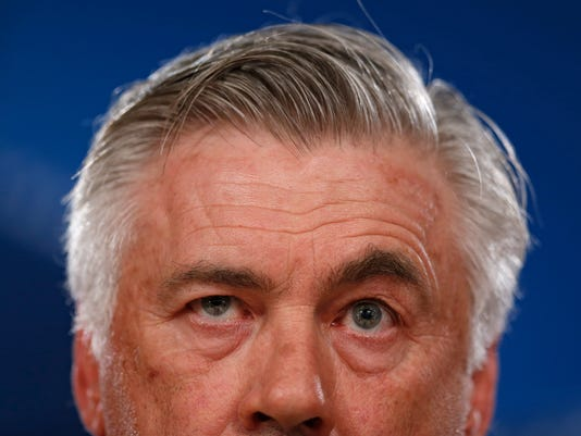 Bayern Munich's head coach Carlo Ancelotti listens to a question during a news conference at the Santiago Bernabeu stadium in Madrid, Monday, April 17, 2017. Bayern Munich will play against Real Madrid a Champions League quarterfinal second leg soccer match on Tuesday 18. (AP Photo/Francisco Seco)