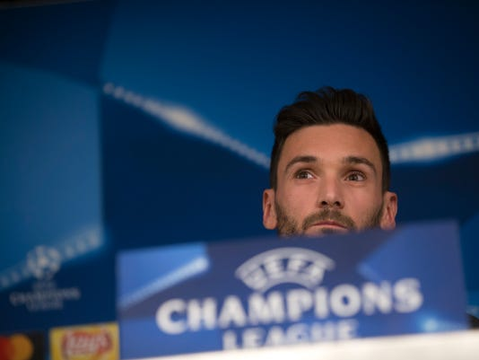 Tottenham goalkeeper Hugo Lloris listens to a question during a news conference at the Santiago Bernabeu stadium in Madrid, Monday, Oct. 16, 2017. Tottenham will play a Champions League group H soccer match against Real Madrid on Tuesday 17. (AP Photo/Francisco Seco)