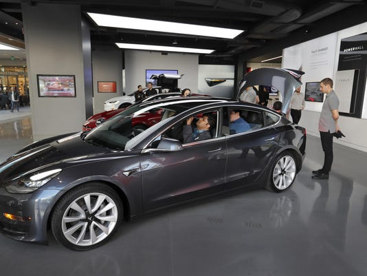 Some early owners of Tesla's Model 3 are reporting quality problems. Do buyers care?