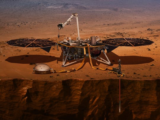 This illustration made available by NASA in 2018 shows the InSight lander drilling into the surface of Mars. InSight, short for Interior Exploration using Seismic Investigations, Geodesy and Heat Transport, is scheduled to arrive at the planet on Nov. 26, 2018.