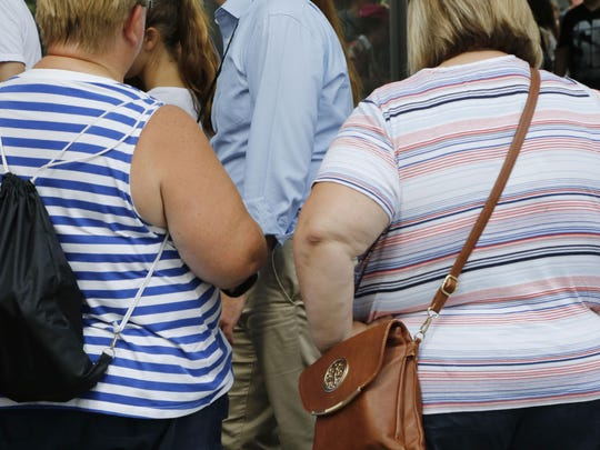 FILE - This Tuesday, Aug. 16, 2016 file photo shows two overweight women in New York. On Tuesday, May 28, 2019, health officials are reporting fewer new cases of diabetes in U.S. adults _ even as obesity rates continue to climb. (AP Photo/Mark Lennihan)