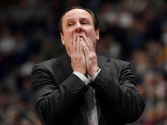FILE - In this Jan. 12, 2020, file photo,  Wichita State head coach Gregg Marshall reacts in the second half of an NCAA college basketball game against Connecticut, in Hartford, Conn. Marshall learned how to build a basketball team while on the staff of Hall of Fame coach John Kresse at College of Charleston. Many of those lessons have helped Marshall become Wichita State's winningest coach. But many have lost their value, and the reason is simple: The NCAA transfer portal has forced coaches to build teams rather than programs. (AP Photo/Jessica Hill, File)