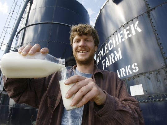 In the raw: John Clark pours unpasteurized milk into a glass at Applecheek Farm in Hyde Park in June 2008. (AP Photo/Toby Talbot)